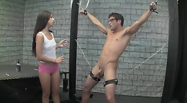 Young teen gives a handjob to a tied slave