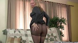 Fuckable mom masturbates in black pantyhose