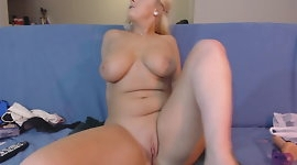 Busty blonde masturbates and squirts
