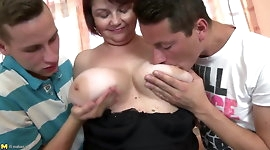 Mature mommy with big saggy tits fucked by two boys