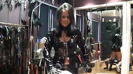 Latex strapon mistress