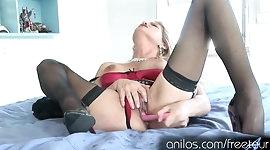 Super cougar strips off her lingerie and fucks a dildo