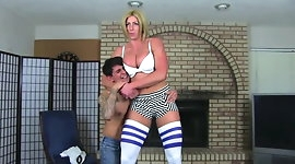 Tall goddess beating up a guy